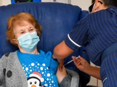 Margaret Keenan becomes the first patient in the United Kingdom to receive the Pfizer/BioNtech covid-19 vaccine at University Hospital, Coventry, administered by nurse May Parsons (Jacob King/PA)