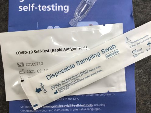 An NHS Test and Trace Covid-19 self-testing kit (PA)