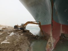 A digger being used to free the Ever Given (Suez Canal Authority/PA)