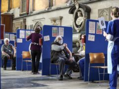 Members of the public receive an injection of the coronavirus vaccine at Salisbury Cathedral (Steve Parsons/PA)