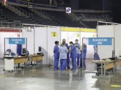Staff at the vaccination centre in the SSE Arena, Belfast (Liam McBurney/PA)