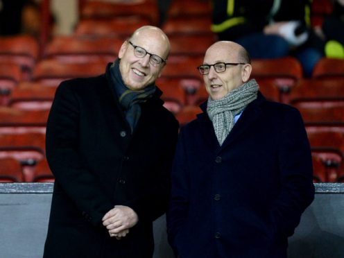 Joel Glazer (right) admits Manchester United's owners need to engage more with fans (Martin Rickett/PA)