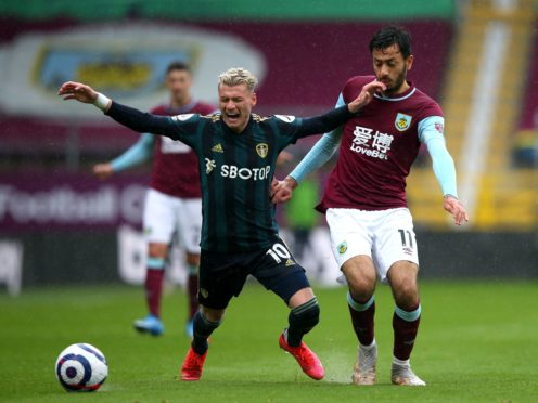 Ezgjan Alioski, left, and Dwight McNeil were involved in an exchange during Leeds' win at Turf Moor in May (Alex Livesey/PA)