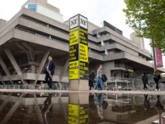People pass the National Theatre, on the South Bank (Dominic Lipinski/PA)