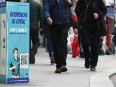 A Covid-19 sign on the high street in Hounslow, west London (Kirsty O'Connor/PA)