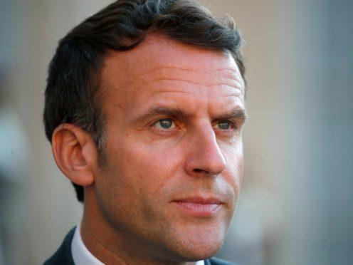 Emmanuel Macron was slapped in the face (Francois Mori/AP)