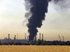 A dark plume of smoke rises up from a main oil refinery south of Tehran, Iran (Ebrahim Noroozi/AP)