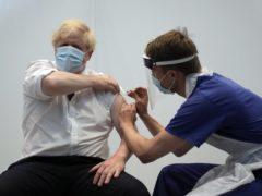 Prime Minister Boris Johnson receives his second jab of the AstraZeneca coronavirus vaccine from James Black, at the Francis Crick Institute in London (Matt Dunham/PA)