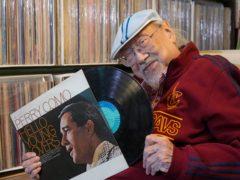 Ray Cordeiro shows a vinyl record at his home in Hong Kong (AP/Kin Cheung)