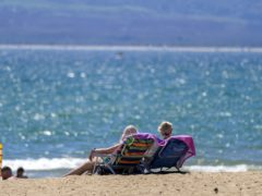 People enjoy the weather on Bournemouth beach in Dorset (Steve Parsons/PA)