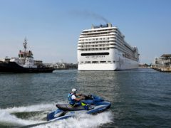 The MSC Orchestra cruise ship exits the lagoon as it leaves Venice (Antonio Calanni/AP)