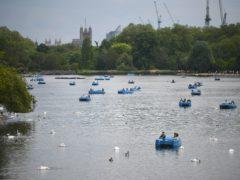 People in pedalos on the Serpentine, Hyde Park, London (Victoria Jones/PA)