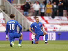 England's Jack Grealish and Kalvin Phillips take a knee before the match (Lee Smith/PA)