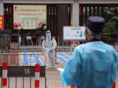 A student leaves after taking a special quarantined exam station for those who have had close contact with recent coronavirus cases in Guangzhou, China (AP)