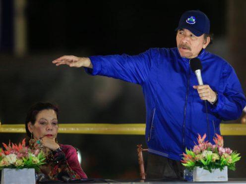 Nicaragua's President Daniel Ortega speaks next to first lady and Vice President Rosario Murillo (Alfredo Ziuniga/AP)