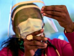 A health worker prepares a dose of the Pfizer coronavirus vaccine (AP)
