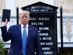 Donald Trump holds a Bible as he visits outside St John's Church (Patrick Semansky/AP)