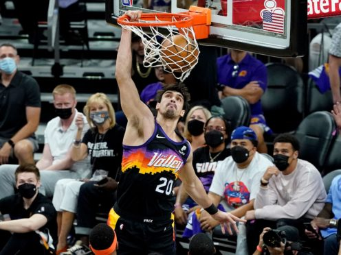 Phoenix Suns forward Dario Saric dunks against the Denver Nuggets during the first half of the Sun's win in Game 2 of their playoff series (Matt York/AP)