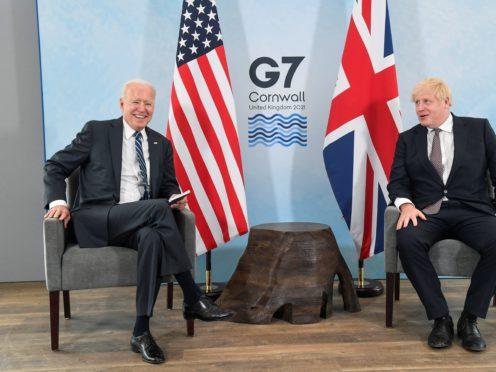 US President Joe Biden talks with Prime Minister Boris Johnson (Toby Melville/PA)