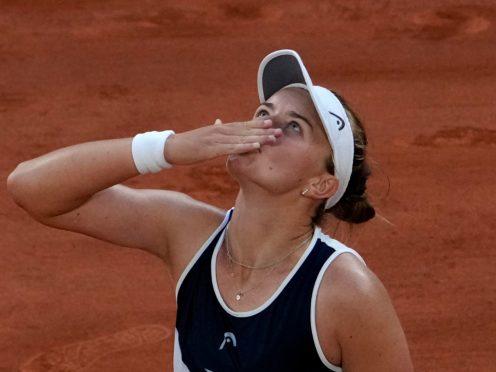 Barbora Krejcikova blows a kiss after battling her way past Maria Sakkari (Christophe Ena/AP)