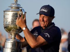Phil Mickelson holds the Wanamaker Trophy after winning the US PGA Championship (David J Philip/AP)