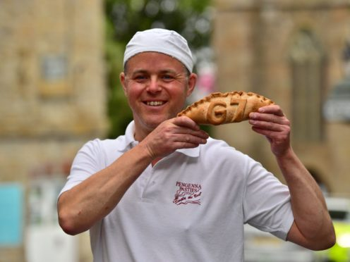 Graeme Parkhill, manager of Pengenna Pasties, holding a commemorative G7 pasty in St Ives during the G7 summit in Cornwall (Ben Birchall/PA)