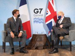 French President Emmanuel Macron with Prime Minister Boris Johnson (Stefan Rousseau/PA)