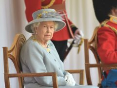 The Queen watches the parade at Windsor Castle (Eddie Mulholland/The Daily Telegraph/PA)