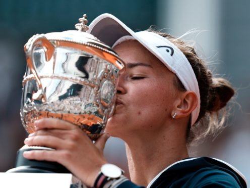 Barbora Krejcikova kisses the Coupe Suzanne Lenglen (Thibault Camus/AP)