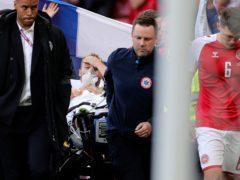 Paramedics use a stretcher to take Denmark's Christian Eriksen off the pitch (Friedemann Vogel/PA)