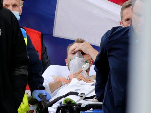 Denmark captain Christian Eriksen was awake as he left the pitch on a stretcher (Friedemann Vogel/AP/PA)