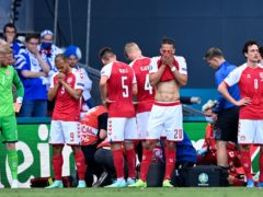 Denmark's players were visibly shaken after Christian Eriksen's collapse during their Euro 2020 game against Finland (Stuart Franklin/Pool via AP)