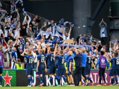 Finland players celebrate with their fans after beating Denmark in their opening group match (Stuart Franklin/Pool via AP)