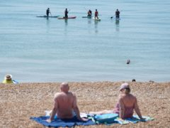 Paddleboarders take to the sea off of Hastings beach in East Sussex. Picture date: Sunday June 13, 2021.
