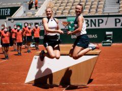 Barbora Krejcikova, right, and Katerina Siniakova do a celebratory leap (Thibault Camus/AP)