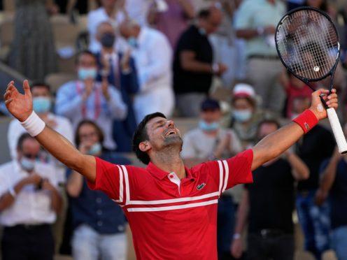 Novak Djokovic celebrates his 19th grand slam title (Michael Euler/AP).
