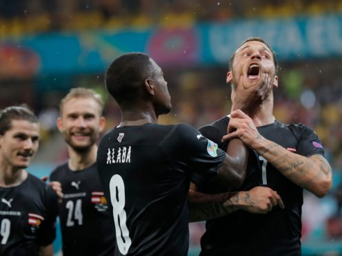 Marko Arnautovic (right) was restrained by team-mate David Alaba after his goal against North Macedonia on Sunday (Robert Ghement/AP)