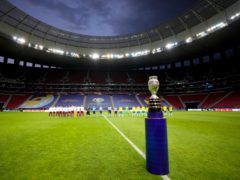 The Copa America trophy is placed on the field prior to the opening match between Brazil and Venezuela at National Stadium in Brasilia (AP)