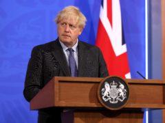 Six parliamentarians claim Boris Johnson unlawfully failed to act on the Russia report (Jonathan Buckmaster/Daily Express/PA)