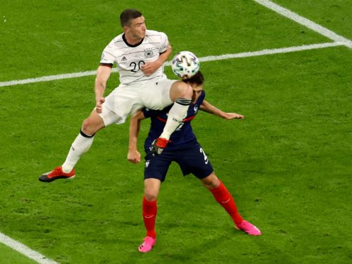 France full-back Benjamin Pavard says he was knocked out following this clash with Germany's Robin Gosens (Alexander Hassenstein/AP)