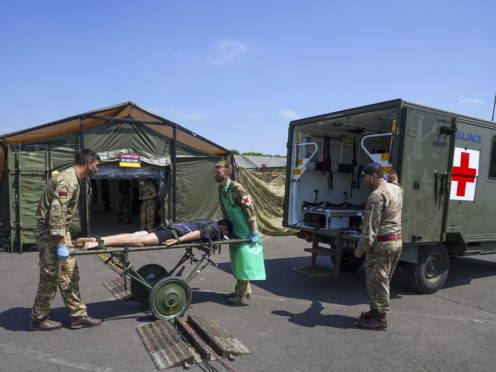 Medical staff from the military services during a test of the Army Medical Service's Mytchett based 22 Field Hospital, at Barton Stacey in Hampshire (Steve Parsons/PA)