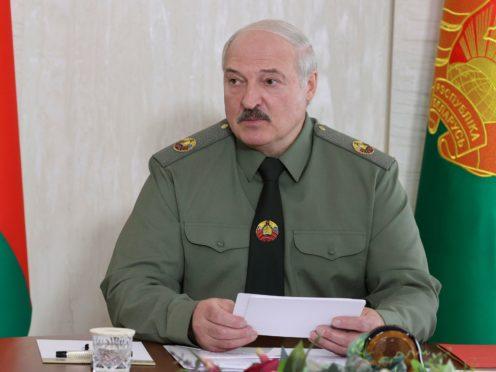 Belarusian President Alexander Lukashenko attends a meeting on territorial defense issues in the town of Shklov, 220 km (137 miles) east of Minsk, Belarus, Wednesday, June 16, 2021. (Maxim Guchek/BelTA Pool Photo via AP)