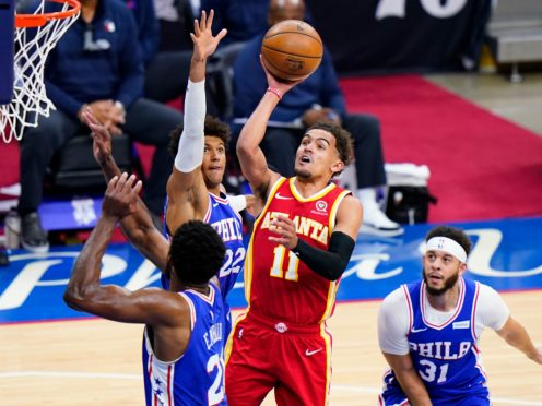 Atlanta Hawks' Trae Young goes up for a shot against Philadelphia 76ers' Joel Embiid (Matt Slocum/AP)