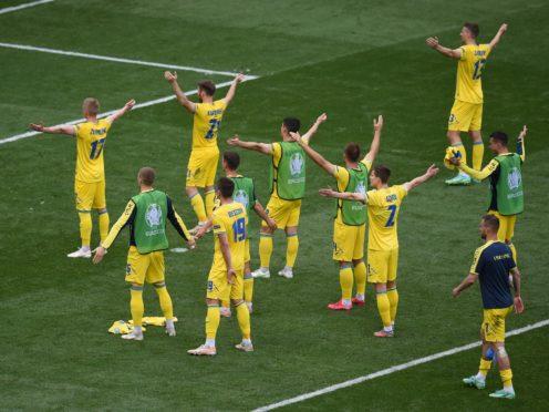 Ukrainian celebrate their win over North Macedonia (Mihai Barbu/AP)