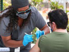 An Orange County resident receives the Covid-19 vaccine in Orlando (Joe Burbank /Orlando Sentinel/AP)