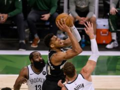 Milwaukee Bucks forward Giannis Antetokounmpo drives between the Brooklyn Nets' James Harden and Blake Griffin (Jeffrey Phelps/AP)