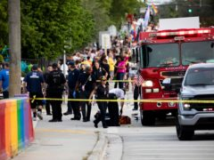 Police and firefighters respond after a truck drove into a crowd of people during The Stonewall Pride Parade and Street Festival in Wilton Manors, Florida (Chris Day/AP)