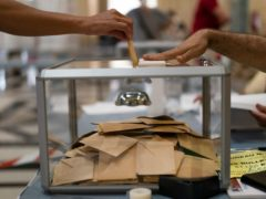 A woman casts her vote during regional elections in Marseille (AP/Daniel Cole)
