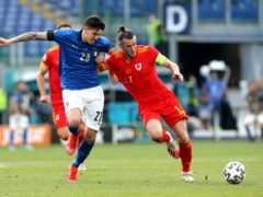 Italy's Alessandro Bastoni (left) and Wales' Gareth Bale battle for possession (Marco Iacobucci/PA)