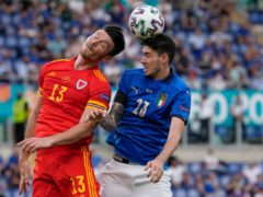 """Wales striker Kieffer Moore, left, was told to """"jump with no arms"""" against Italy by manager Robert Page to avoid a booking and Euro 2020 ban (Alessandra Tarantino/AP)"""